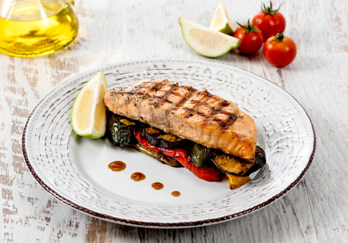Grilled salmon fillet with seasonal vegetables